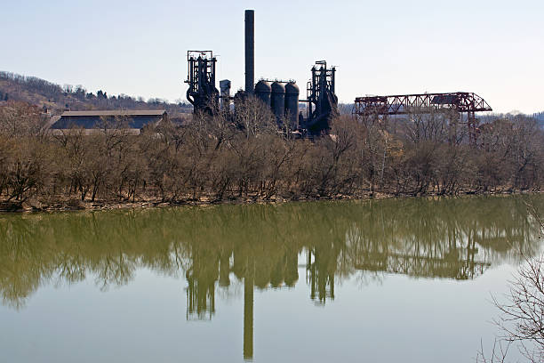 Carrie Blast Furnace & Gantry Crane Reflections Carrie Blast Furnace, Gantry Crane and Their Reflections on the Monongahela River monongahela river stock pictures, royalty-free photos & images