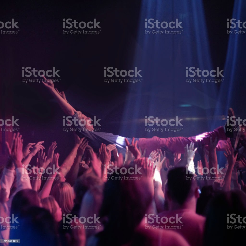 Carried by an amazing crowd! stock photo