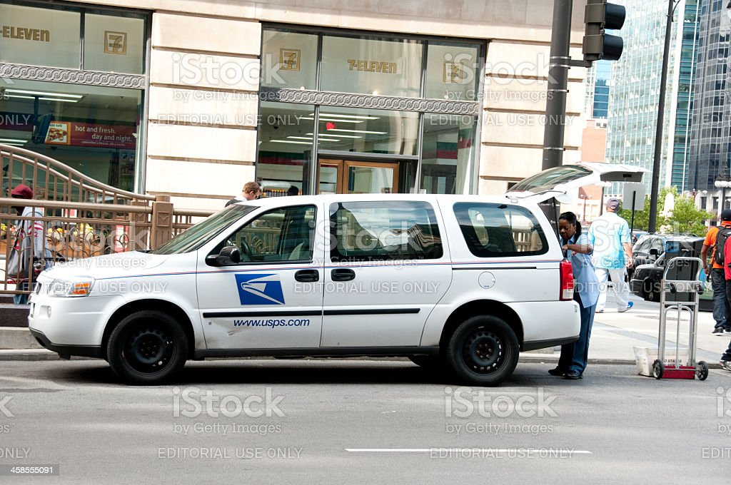USPS carrier unloading a van royalty-free stock photo