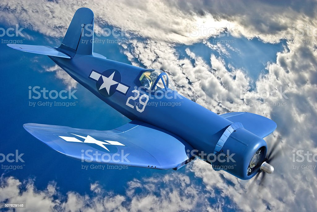 Carrier-based fighter is flying against the blue sky stock photo