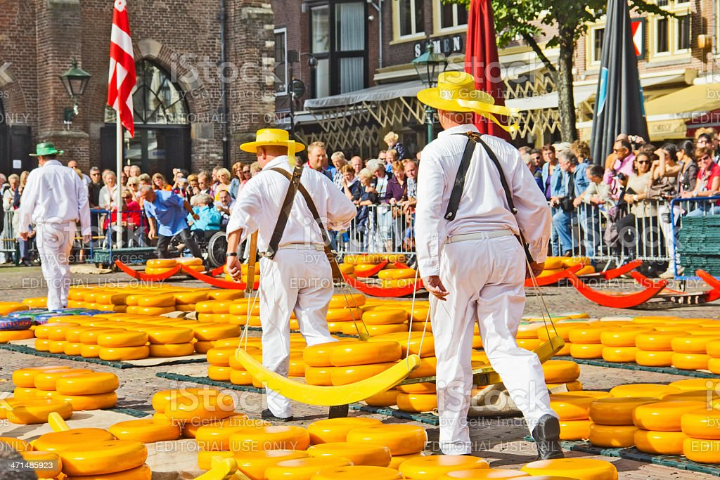 Carriers walking in the famous Dutch cheese market stock photo