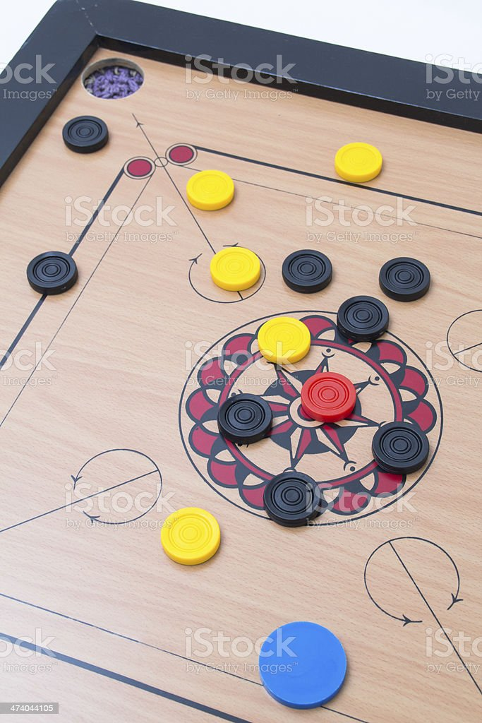 carrom board game playing stock photo