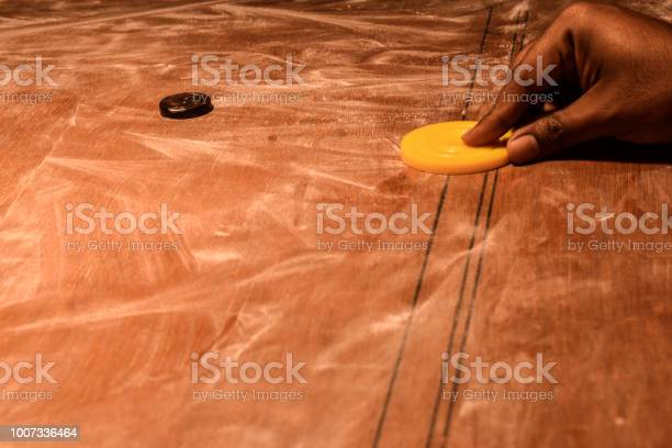 Player Playing A Game Of Carrom In Night