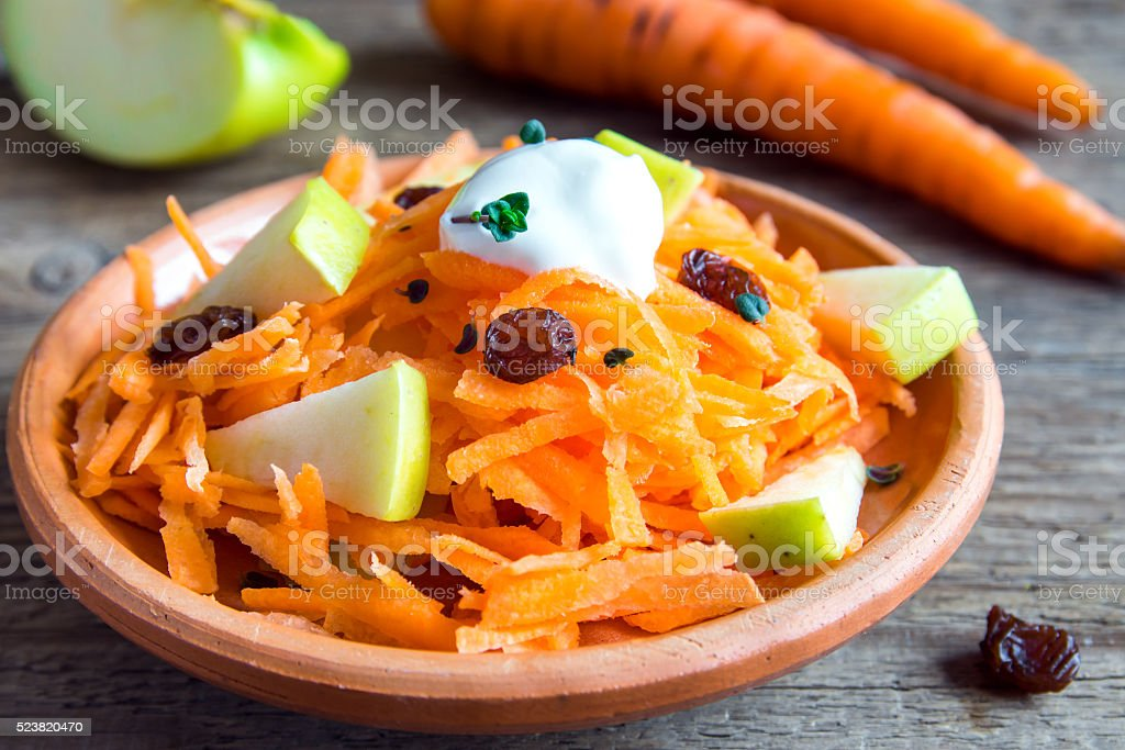 Carrot and apple salad with raisin stock photo