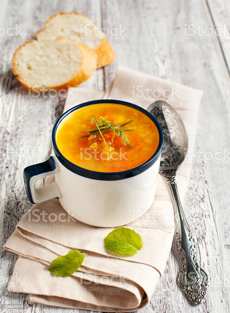Carrot and ginger soup with red lentils stock photo