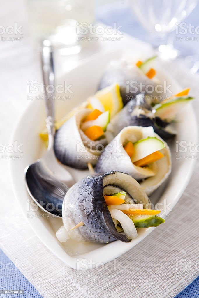 Carrot and Onion Wrapped in Herring stock photo