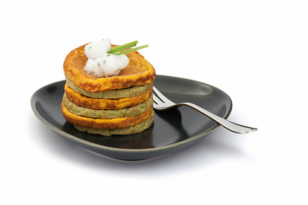 Carrot and spinach pancakes stock photo
