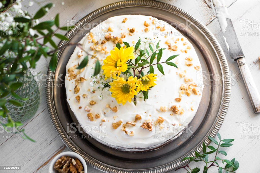 Carrot cake decorated with flowers stock photo