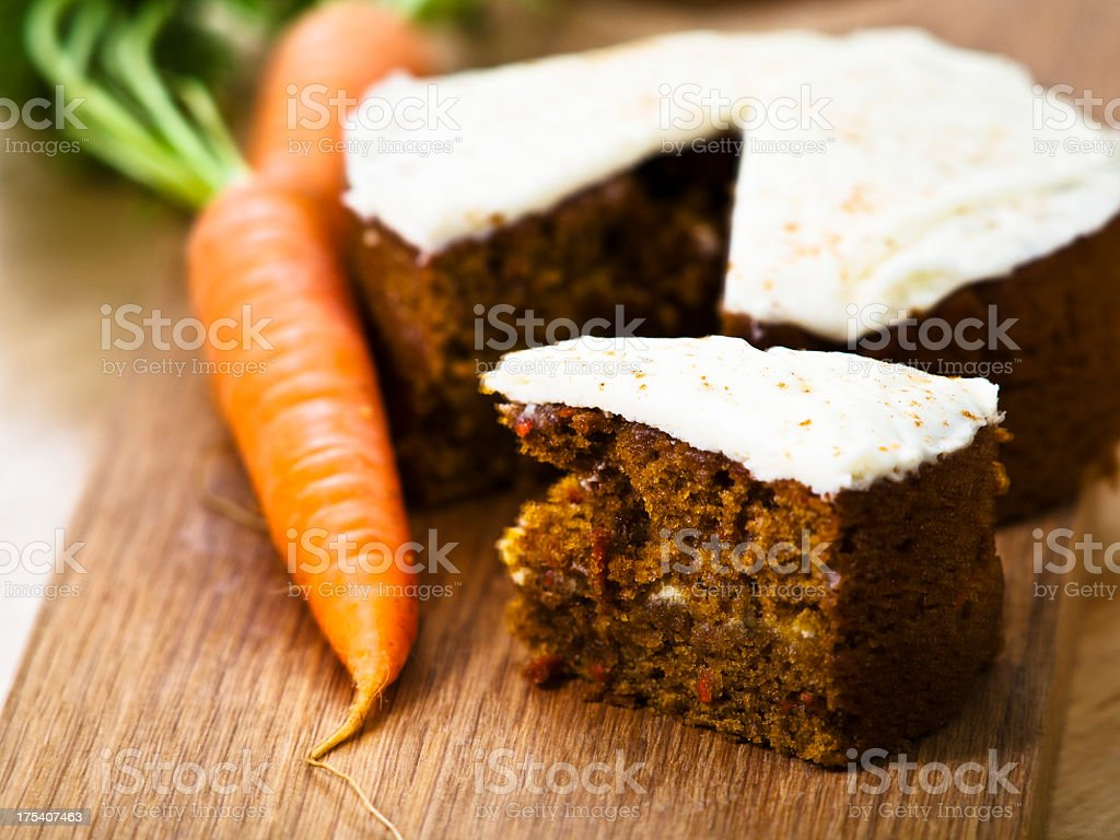 Carrot cake with a carrot on the side royalty-free stock photo