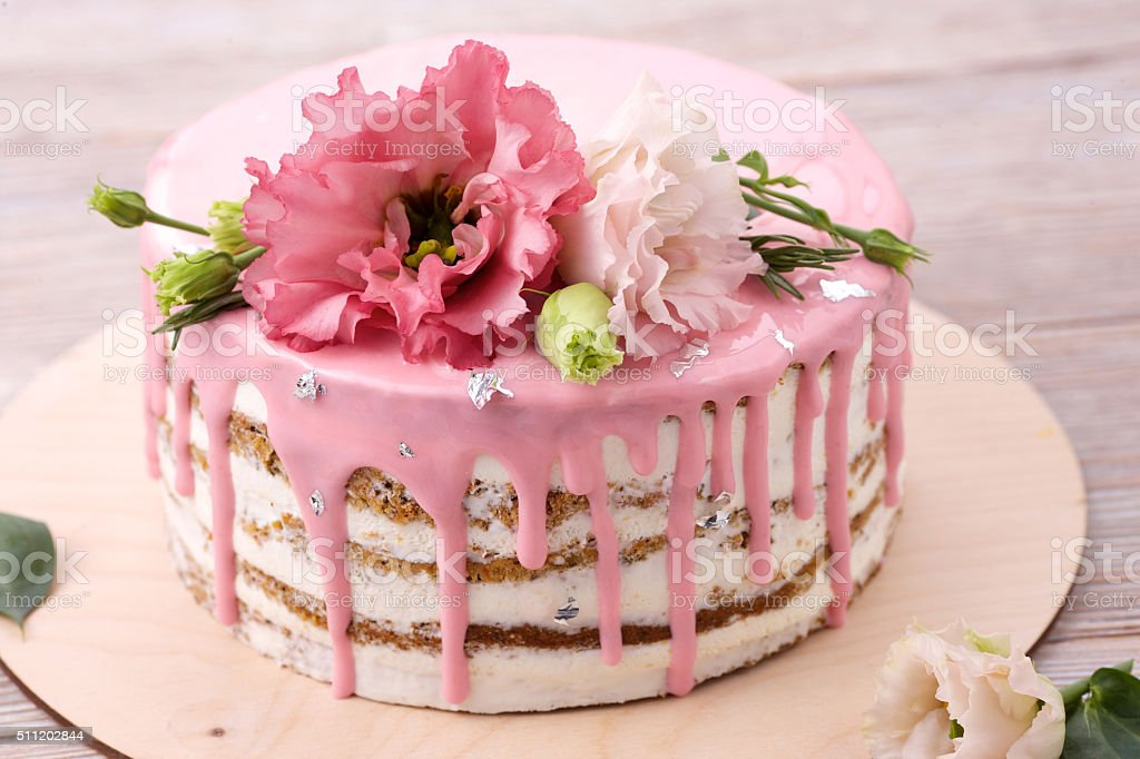 Carrot cake with pink glaze