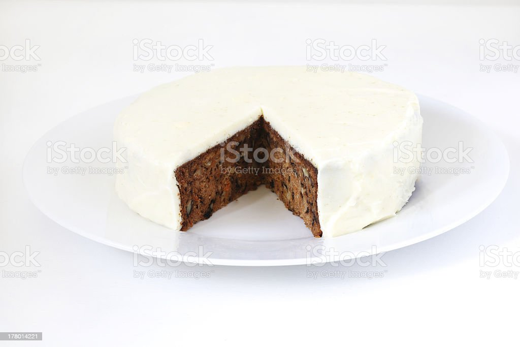 Carrot cake with walnuts, cream cheese and sugar icing royalty-free stock photo