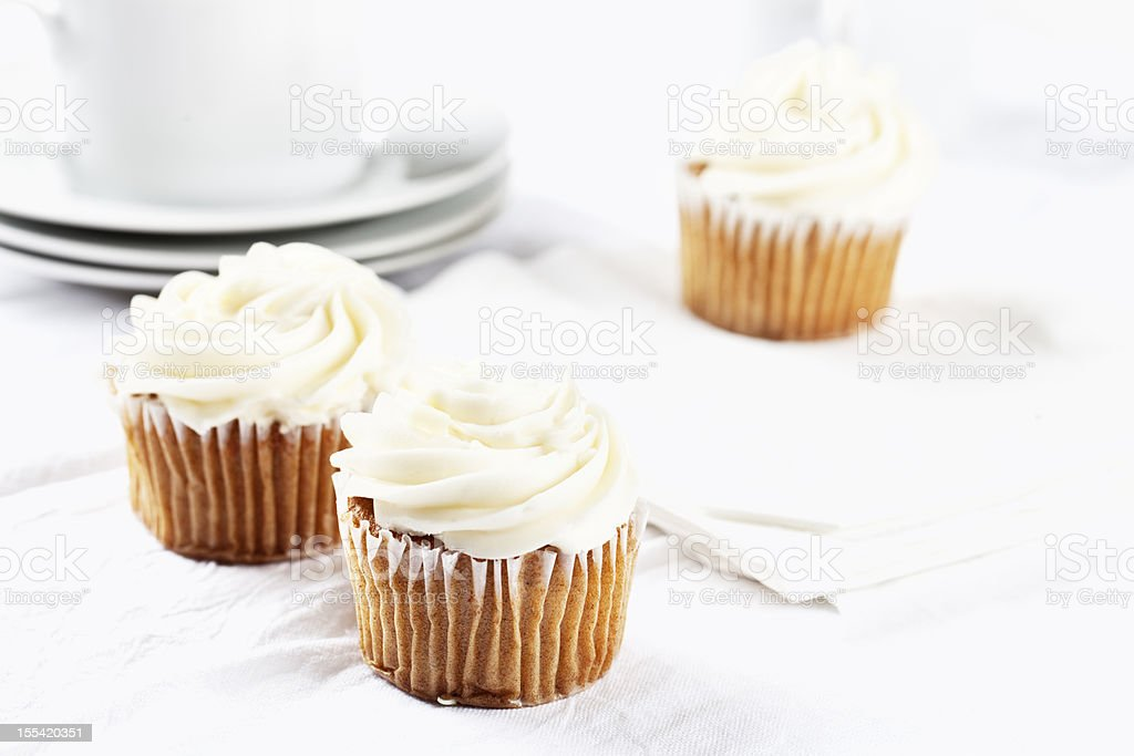 carrot cupecakes with vanilla icing stock photo