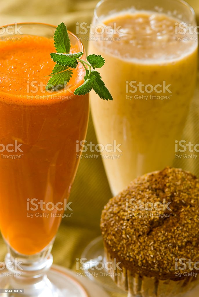Carrot Juice and Banana Smoothie with Bran Muffin royalty-free stock photo