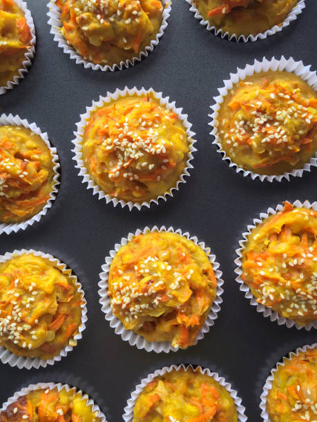 Carrot muffins close-up Top view of fresh carrot muffins just out from the oven muffin tin stock pictures, royalty-free photos & images