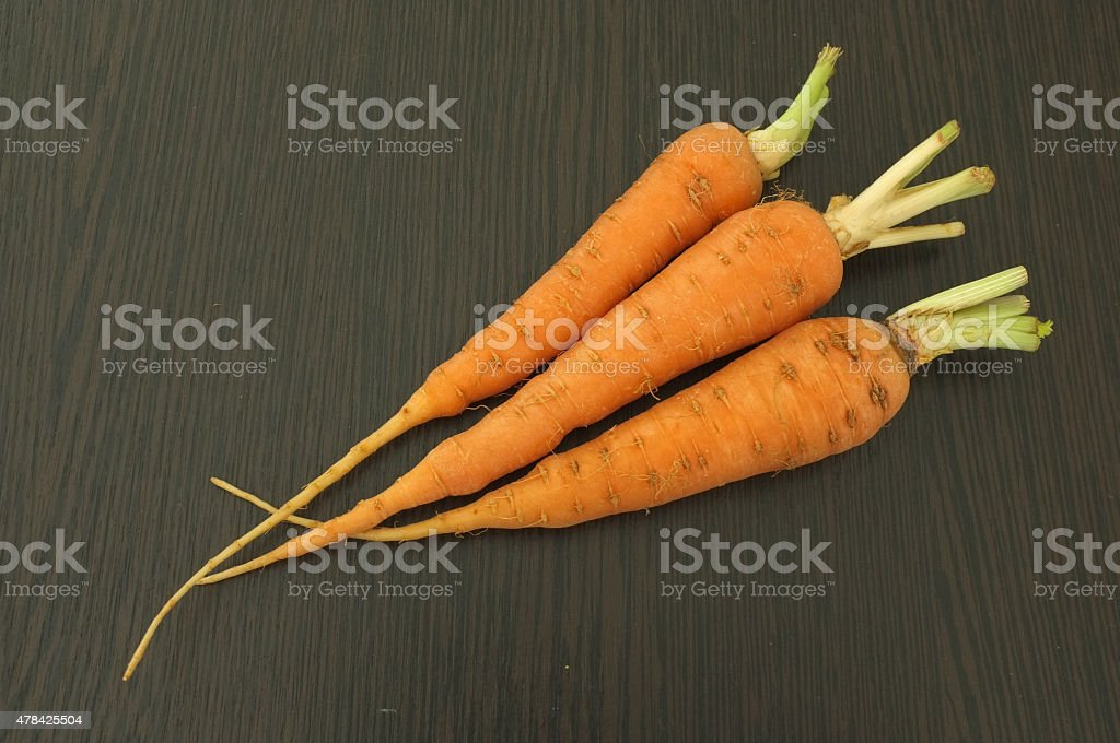 Carrot on wooden background stock photo