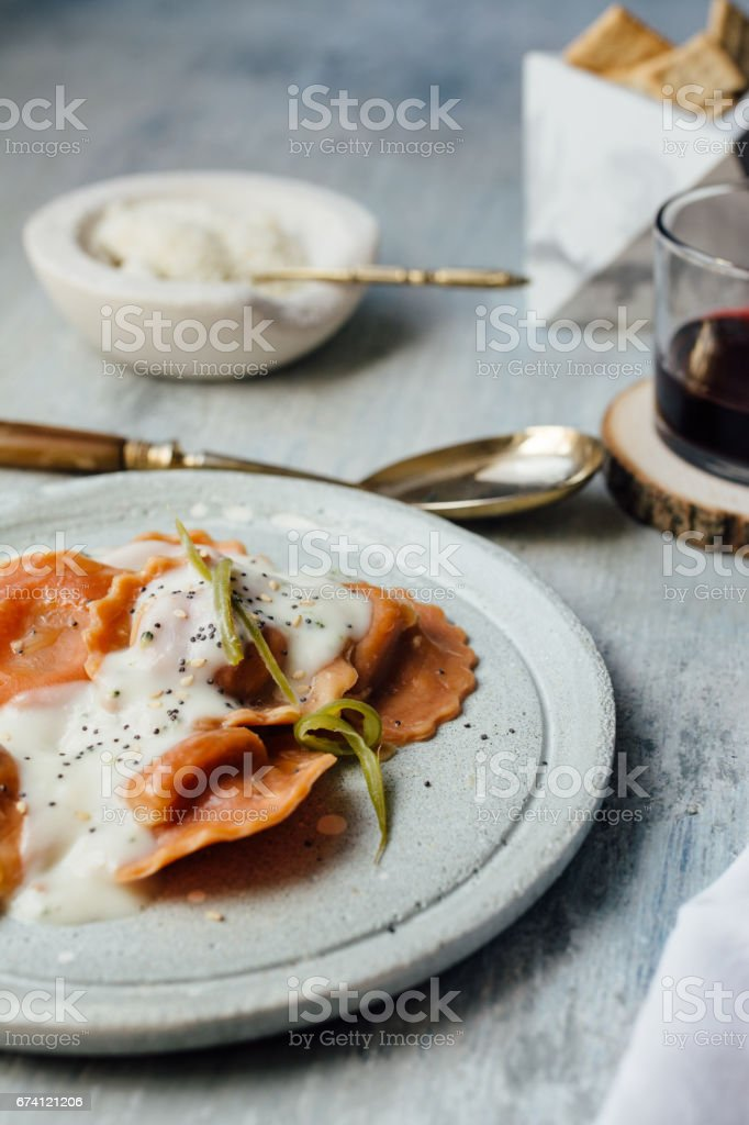 Carrot pasta stuffed with cheese and vegetables royalty-free stock photo