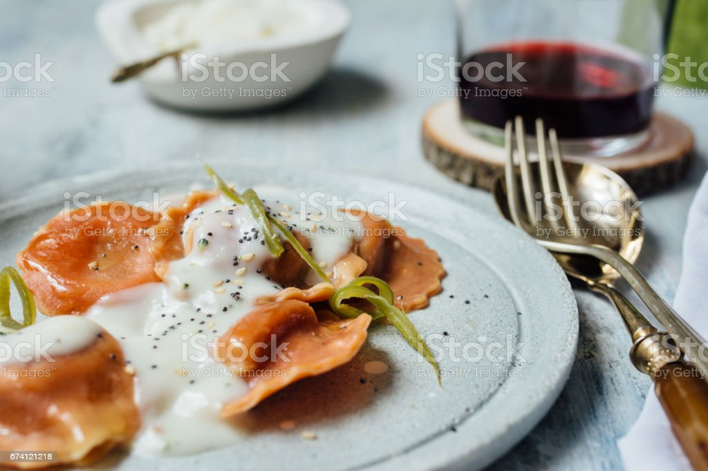 Carrot pasta stuffed with cheese and vegetables 免版稅 stock photo