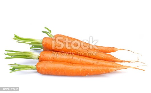 The essential oil of carrot seeds in a glass bottle closeup horizontal. top view