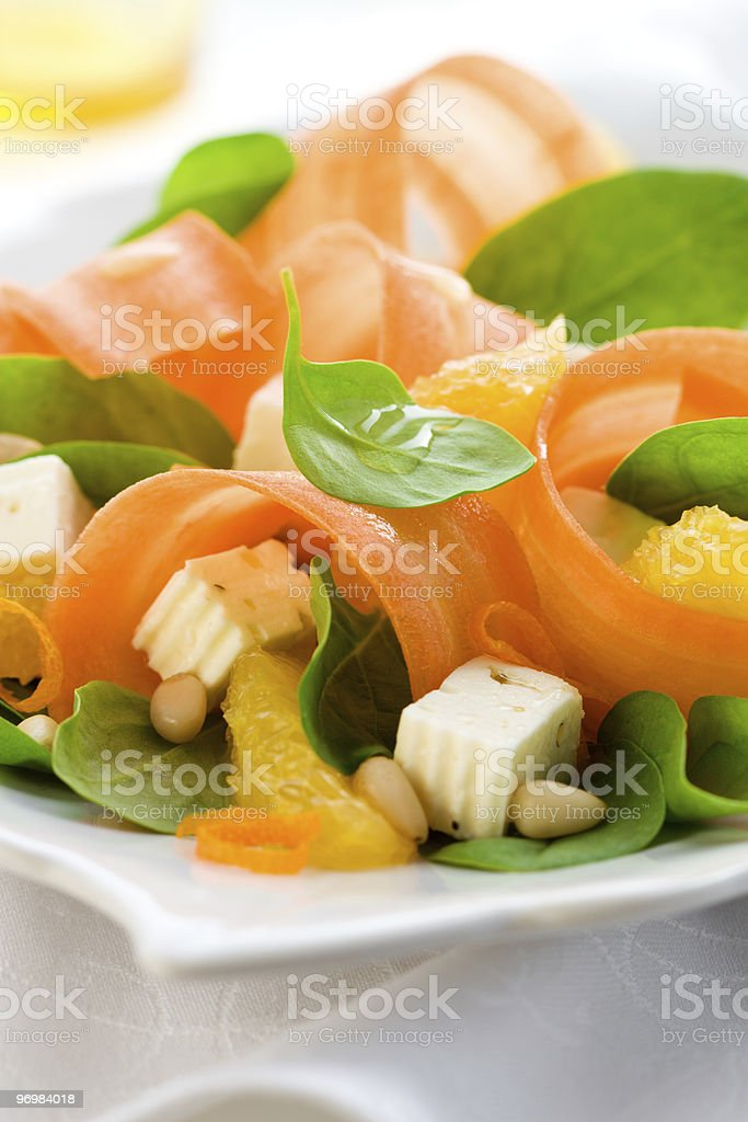 carrot salad with spinach, feta and orange royalty-free stock photo