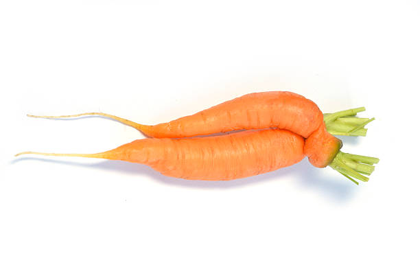 carrot shapes isolated on a white background stock photo