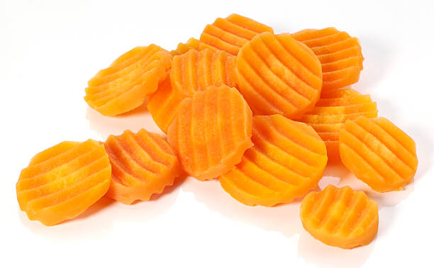 Carrot slices of different sizes isolated in white stock photo