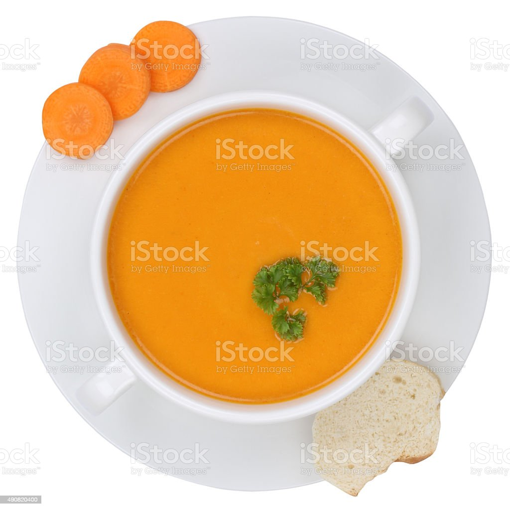 Carrot soup with carrots in bowl from above isolated stock photo