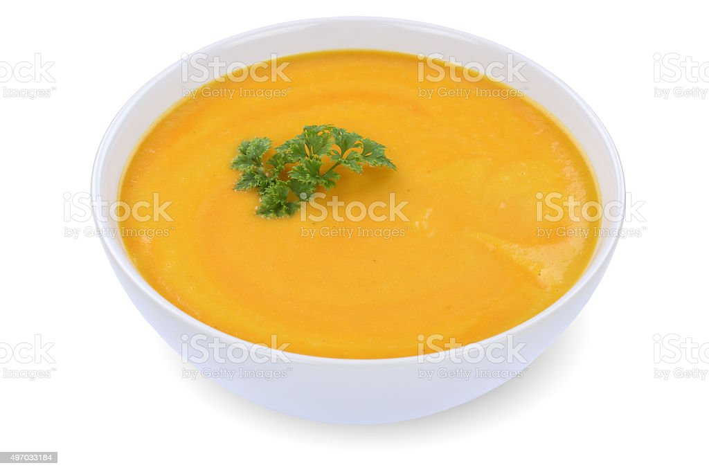 Carrot soup with carrots in bowl isolated stock photo