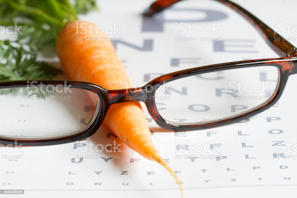 Carrot vitamin A and eye test chart healt medical  concept stock photo