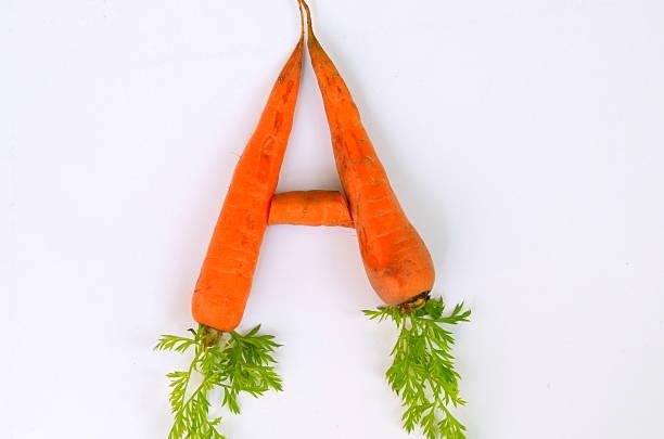 carrot.  vitamin a - vitamina a fotografías e imágenes de stock