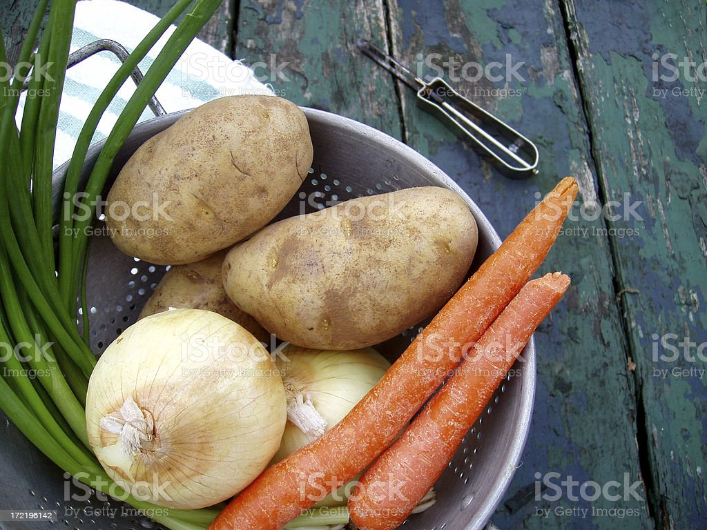 Carrots and fresh vegetables with peeler stock photo