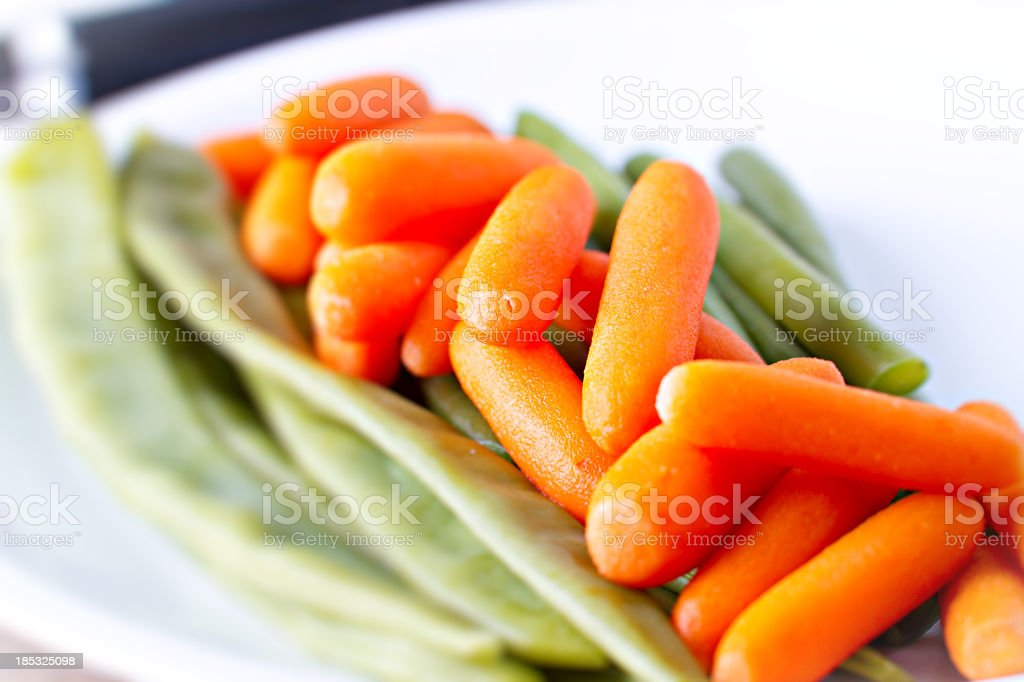 Carrots and green beans royalty-free stock photo