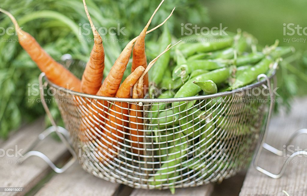 Carrots and green peas stock photo