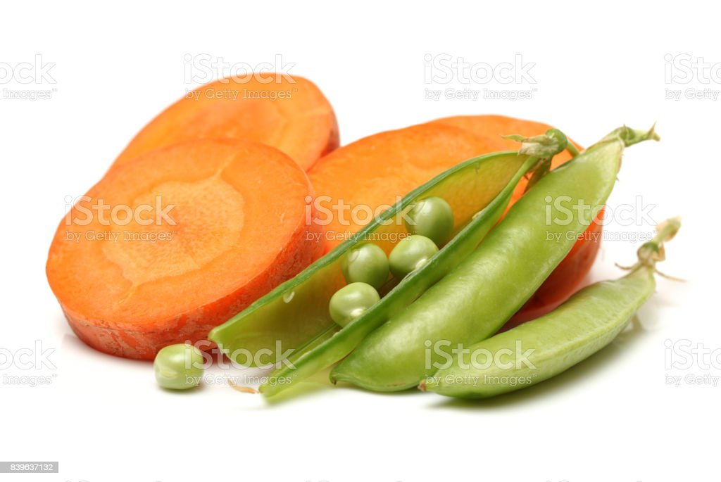 Carrots and peas pod  on the white background stock photo