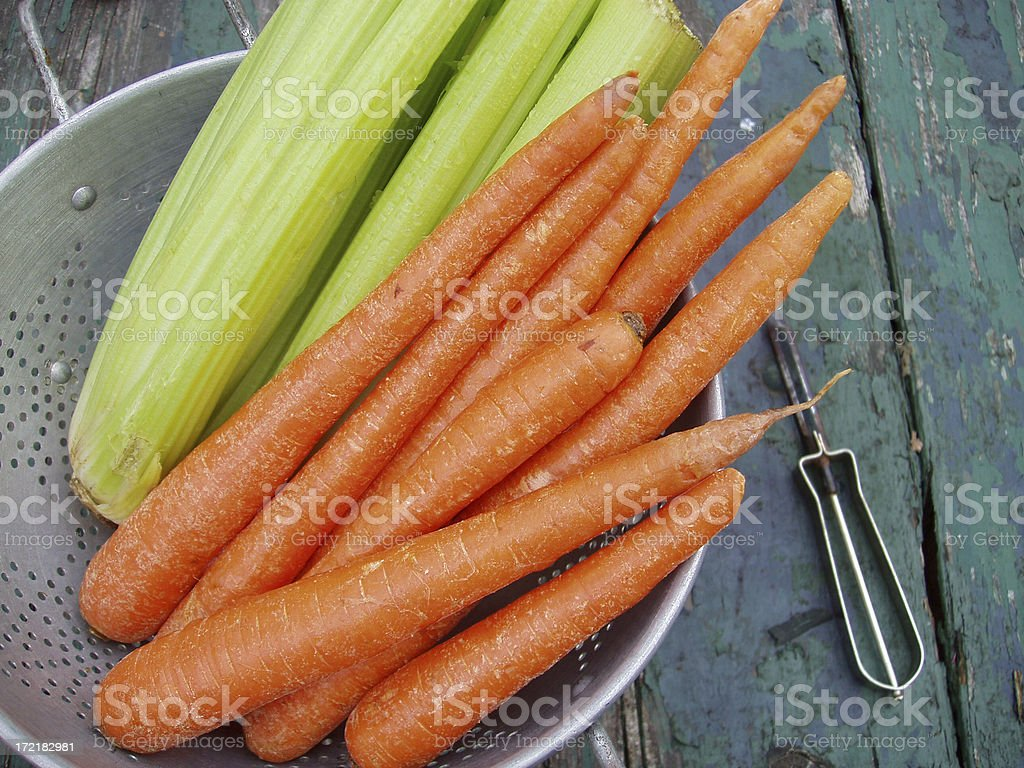 Carrots & Celery with Antique Peeler - Fresh Vegetables stock photo