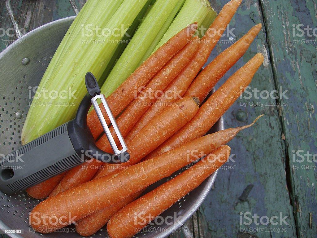 Carrots & Celery with Peeler - Fresh Vegetables stock photo