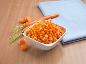 Carrots in bowl on wooden table