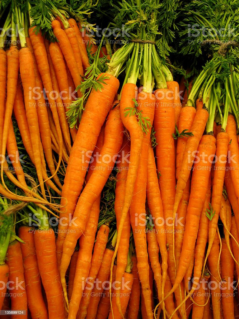 Carrots in bundles at marketplace royalty-free stock photo