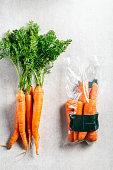 istock Carrots in plastic bag VS NO bag. Say NO to plastic 1151006414