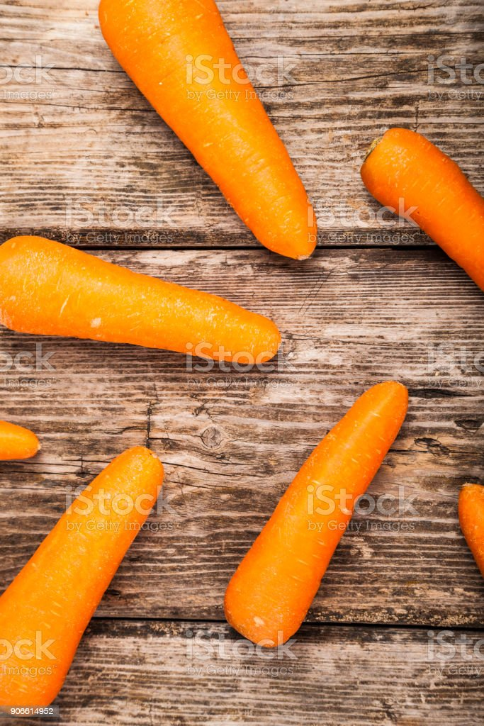 Carrots on a wooden table. stock photo