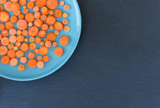 Carrots on blue plane - foto stock