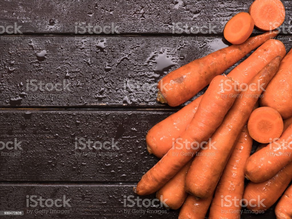 carrots on kitchen table stock photo