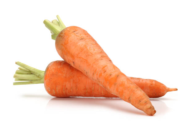carrots on the white background - cenoura imagens e fotografias de stock
