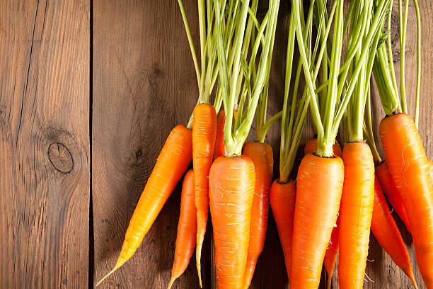 carrots on wood - carrots stock photos and pictures