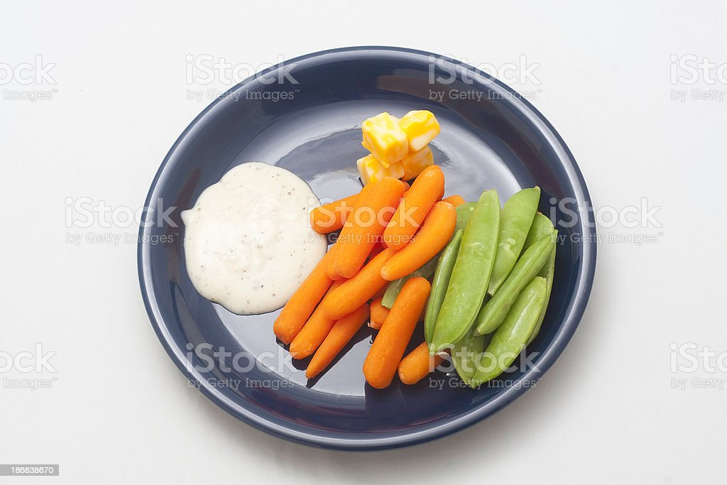 carrots, peas, cheese and ranch dressing stock photo
