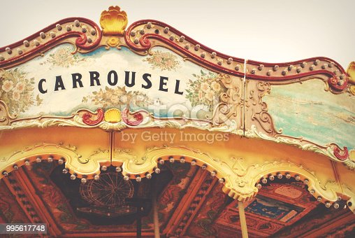Photography of a horse carrousel attraction in an amusement park.