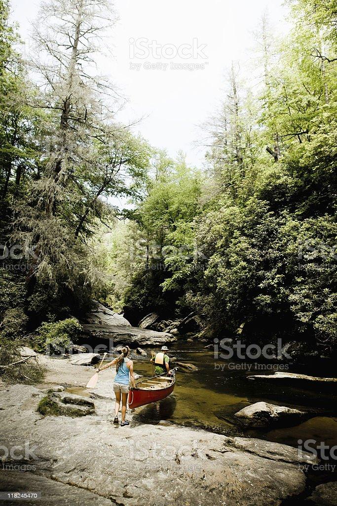 Carry Canoe over Rock royalty-free stock photo