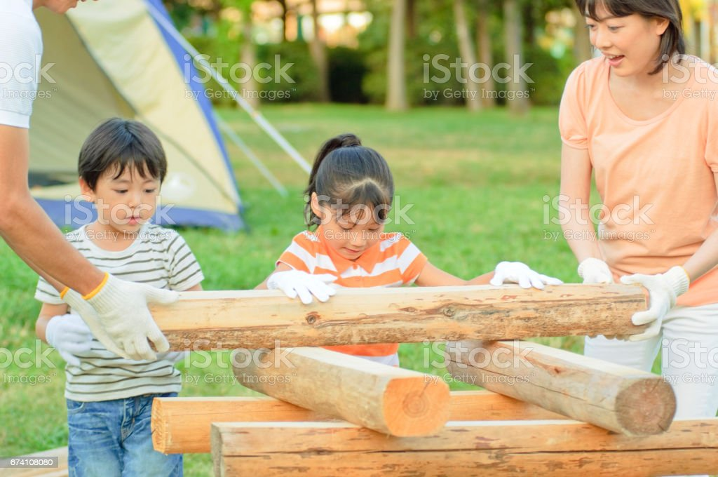 Carry the wood for the campfire family royalty-free stock photo
