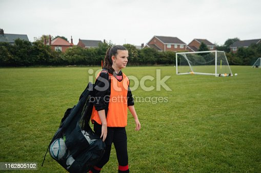 istock Carrying A Bag of Footballs 1162805102