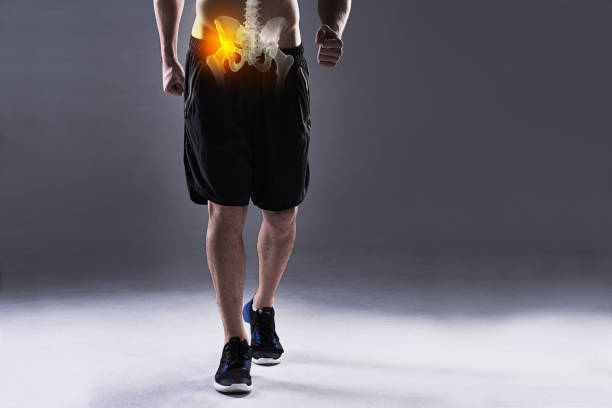 Carrying a hip injury stock photo