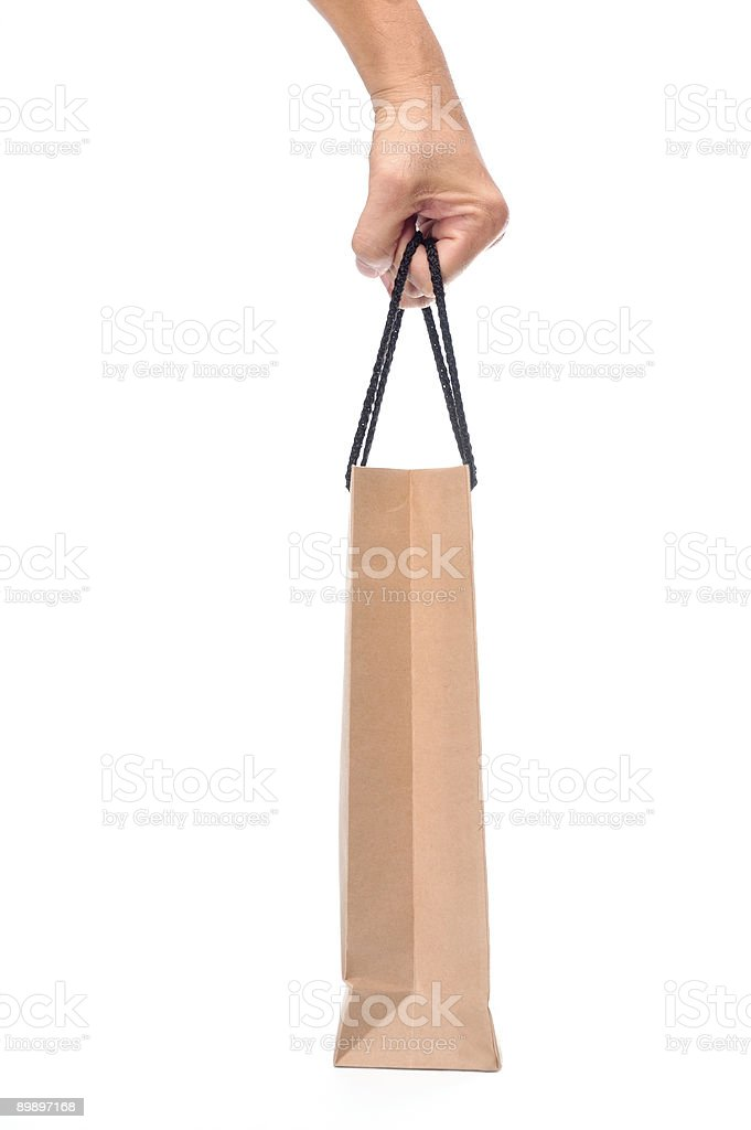 Carrying a paper bag royalty-free stock photo